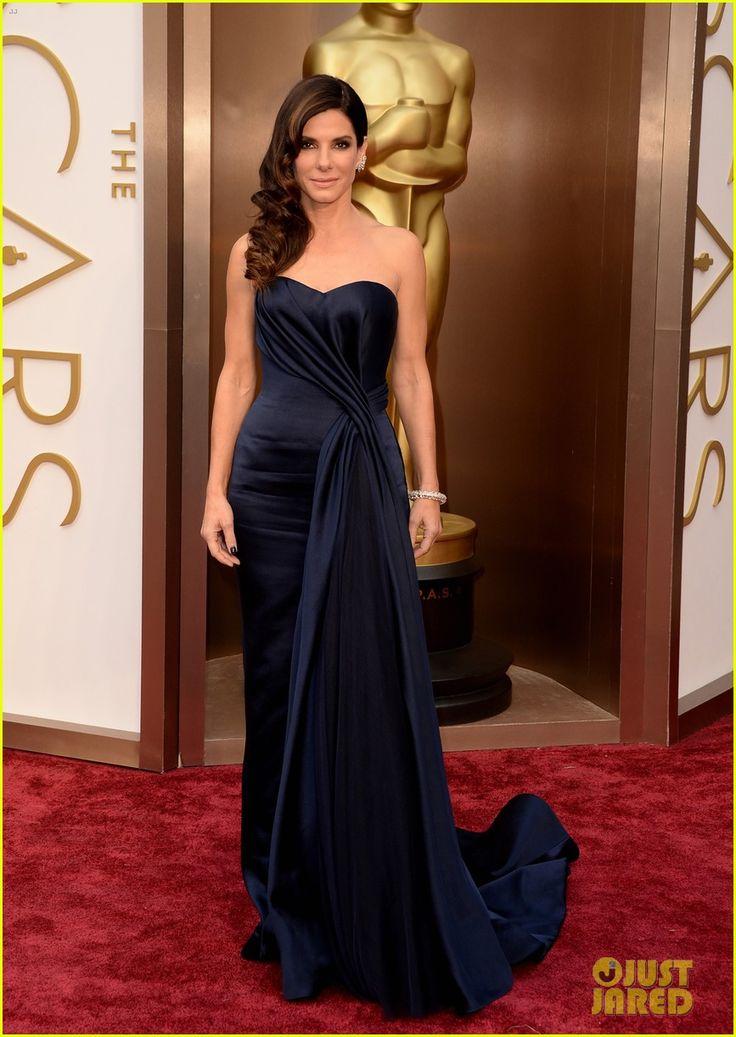 Sandra Bullock Gravitates to the Oscars 2014 Red Carpet. Sandra is wearing an Alexander McQueen dress and Lorraine Schwartz jewelry.