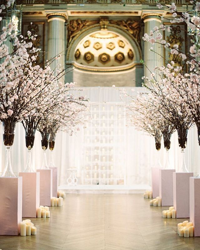 Our jaws hit the floor when we saw Ashley and Shane's ceremony space at Andrew W. Mellon Auditorium--@ADominickEvents and @AmaryllisInc made such amazing use of the cherry blossoms that were blooming at the time in Washington D.C.! See more in #SouthernWeddingsV8 and on #SouthernWeddings today (link in profile). By @AbbyJiu.