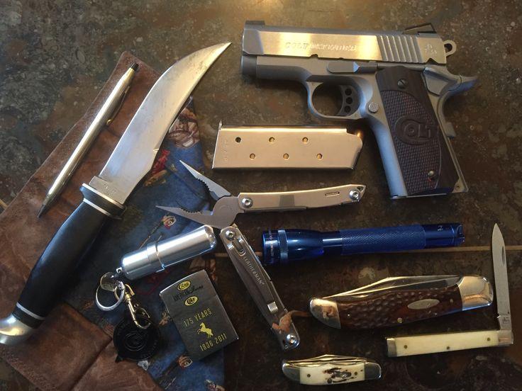 Colt, Case, Zippo EDC plus Pamela's perfect pocket square, Wingman Leatherman, Maglite, Cross pen, Zippo fuel cell, and Case knives