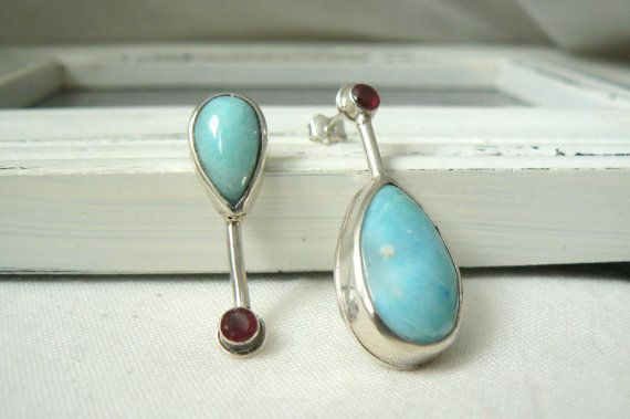 Earring 250/365 + 259/365 Pair of Earrings made of sterling silver, (.925) larimar pear cabochons and 4 mm round ruby.  They measure 3.4 and 3.9 cm long.  You will receive your earrings in a small gift box, ready to give or to keep for yourself.  For any other information, do not hesitate to communicate with me.  ****  This listing is for a pair of earrings, part of a 365 days challenge to make one single earring per day. These earrings are meant to be worn alone or paired with anot...