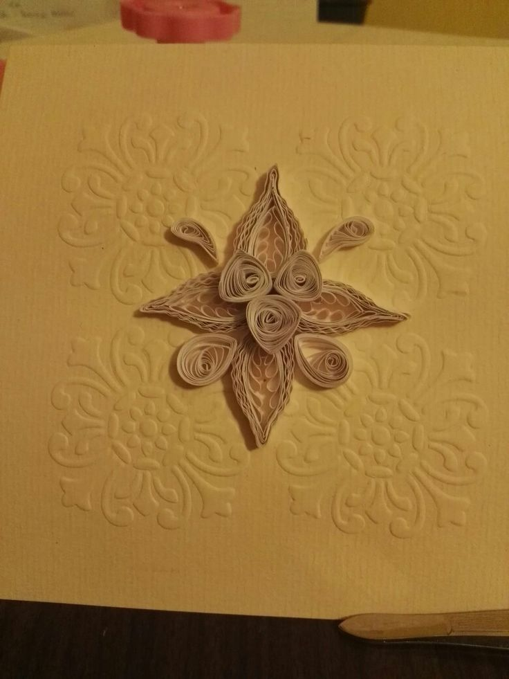 embossing with quilling  flower. this is a postcard and exercise