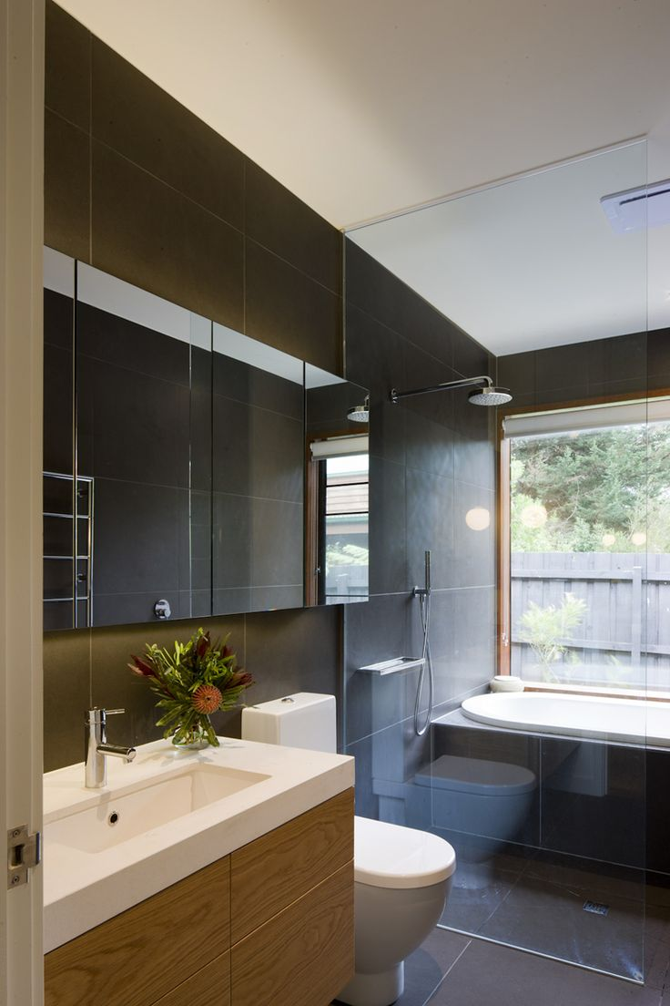grey floor to wall tiles + timber vanity
