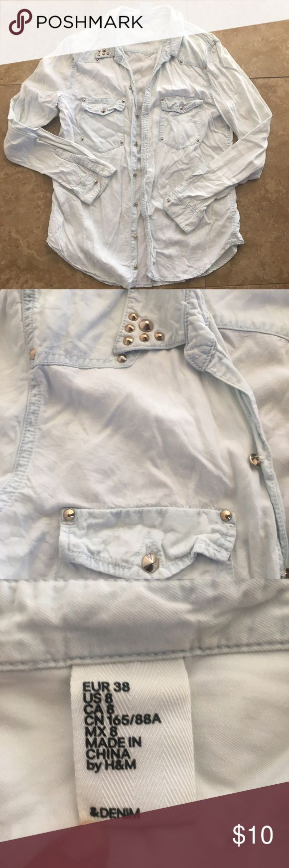 H&M studley Denim H&M Denim shirt. Fun denim shirt with a lot of edge. This Denim shirt has studs for buttons and a studley accent on collar. There are two stains on the denim maybe they can be dry cleaned out. Size 8 /medium H&M Tops Button Down Shirts