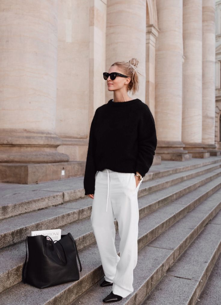 Céline baby Audrey sunglasses, Acne Studios knit, Cos silk trousers, Céline bag and boots. Via Mija