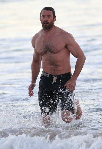 Hello muscles! Hugh Jackman goes for an early morning swim at Bondi Beach in Sydney, Australia on July 16, 2012.