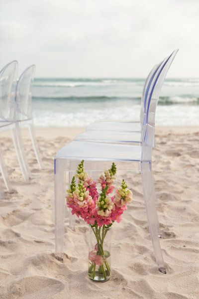 ghost chairs and seaside nuptials = such a good mix | Photography by jenphilips.com | Design by http://www.thedazzlingdetails.com |   Read more - http://www.stylemepretty.com/2013/08/02/punta-de-mita-wedding-from-the-dazzling-details/