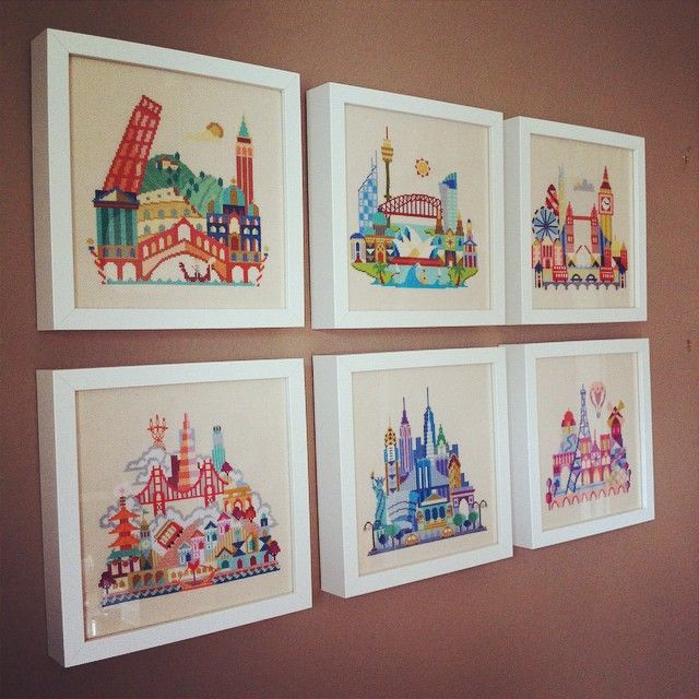 Framed collection of pretty little city cross stitches. Patterns by Satsuma Street on etsy. These examples stitched by leanderpanda7 on Instagram.