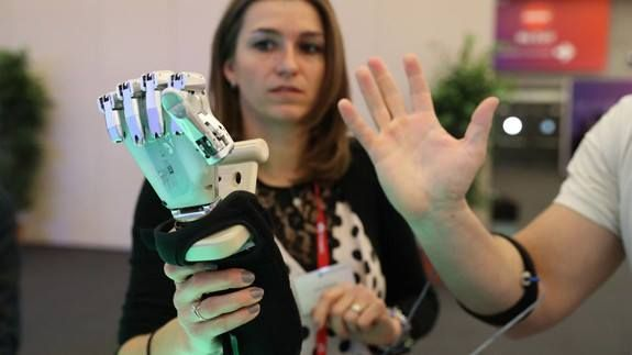 """I moved a robotic hand using (basically) my mind Read more Technology News Here --> http://digitaltechnologynews.com  In the nether regions of the """"NEXTech"""" area of Fira Gran Via the enormous venue in Barcelona where Mobile World Congress is taking place I've learned that graphene is important.   Among the several startups and research projects that heavily rely on the use of graphene a carbon allotrope that's thin durable and conducts electricity well the most interesting was Italian…"""