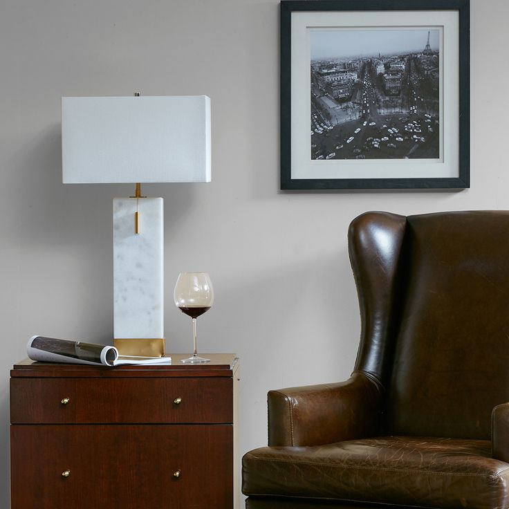 Featuring a marble-finished base and white linen shade, the Bringham Table Lamp looks will compliment any mid-century styled room. This smaller scale will be perfect for a desk or side table.