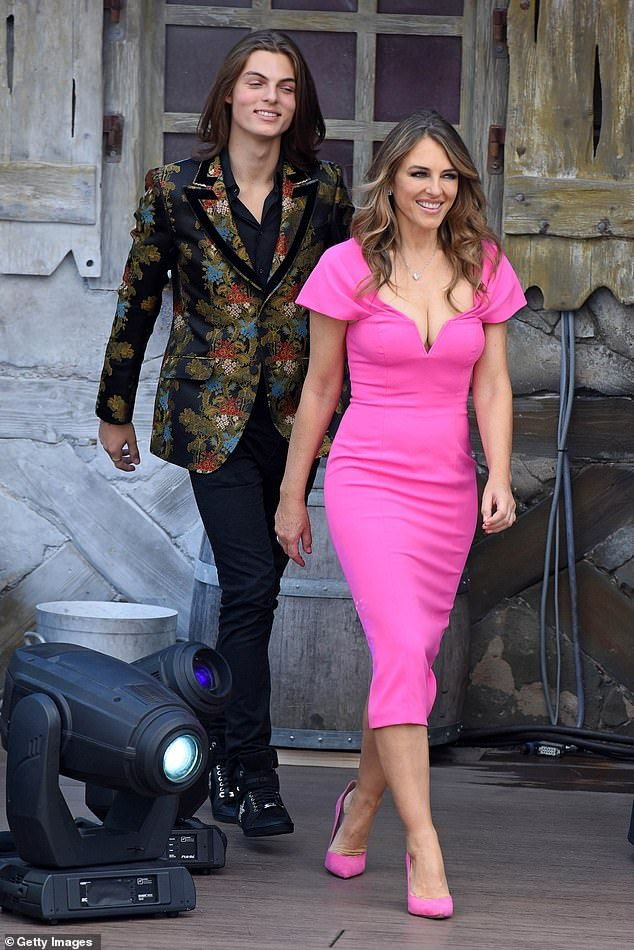 Elizabeth Hurley 53 Dazzles On Outing With Son Damian 16 In 2020 Elizabeth Hurley Hot Pink Midi Dress Fashion Clothes Women