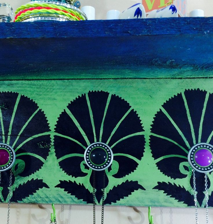 Reclaimed wood floating shelves /wall hanging shelf/ decorative accent shelving/ pallet wood Art Deco stenciled design 4 green hooks 3 knobs by ThePovertyBarn on Etsy https://www.etsy.com/listing/221002284/reclaimed-wood-floating-shelves-wall