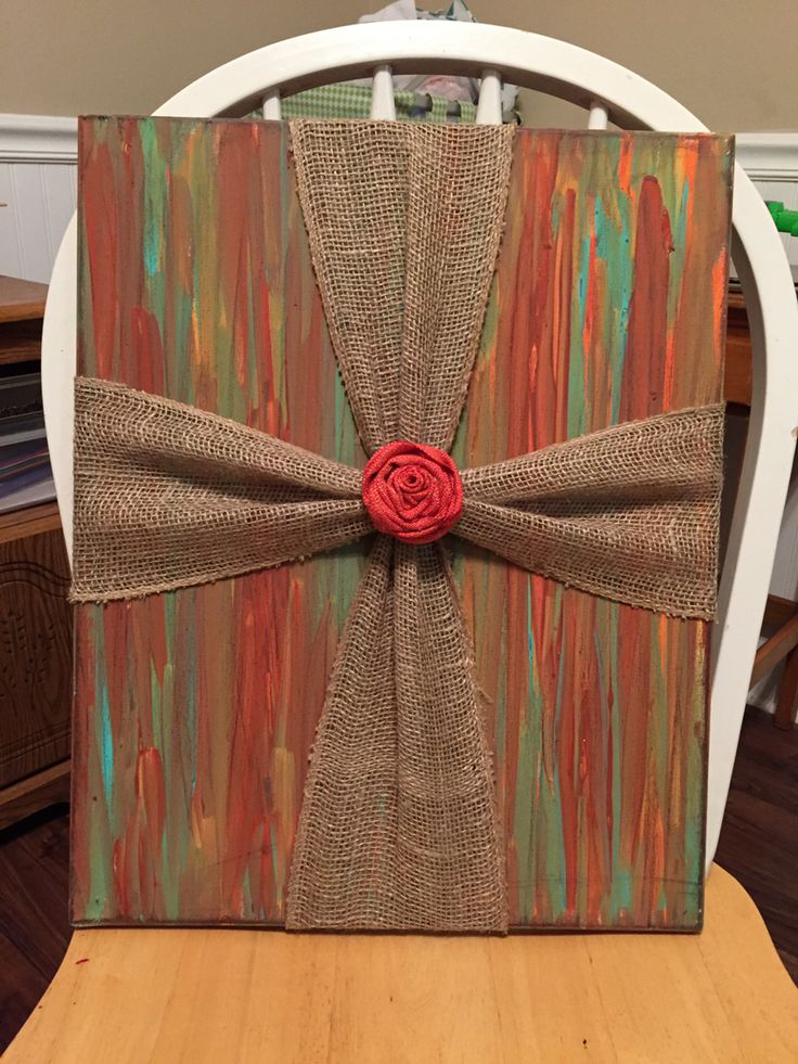 Burlap cross on painted canvas