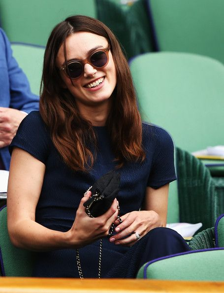 Keira Knightley Photos Photos - Keira Knightley sits in the Royal Box on Centre Court before the Ladies' Singles final match between Eugenie Bouchard of Canada and Petra Kvitova of Czech Republic on day twelve of the Wimbledon Lawn Tennis Championships at the All England Lawn Tennis and Croquet Club on July 5, 2014 in London, England. - Day Twelve: The Championships - Wimbledon 2014