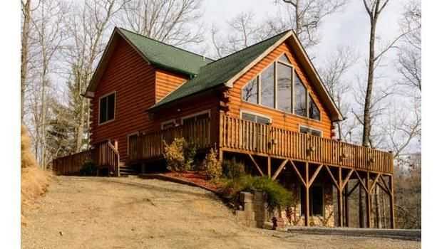 Priced $18,000 below appraisal. Beautiful, open, spacious log home in Waterfall Valley. Huge windows in great room frame winter views around the stone fireplace. Wrap around porch accessible from master suite. Lower Level currently used as guest suite. Drive home every day along an incredible trout stream. Cataloochee Ski Resort, Great Smoky Mtns and Maggie Valley are minutes away. Home is equipped w/4 BRs but on 3BR Septic.