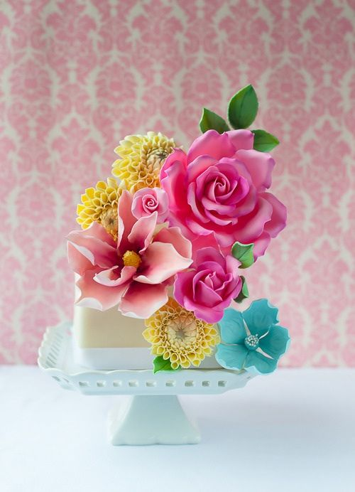 Gorgeous little cake with purple, blue, and yellow flowers!