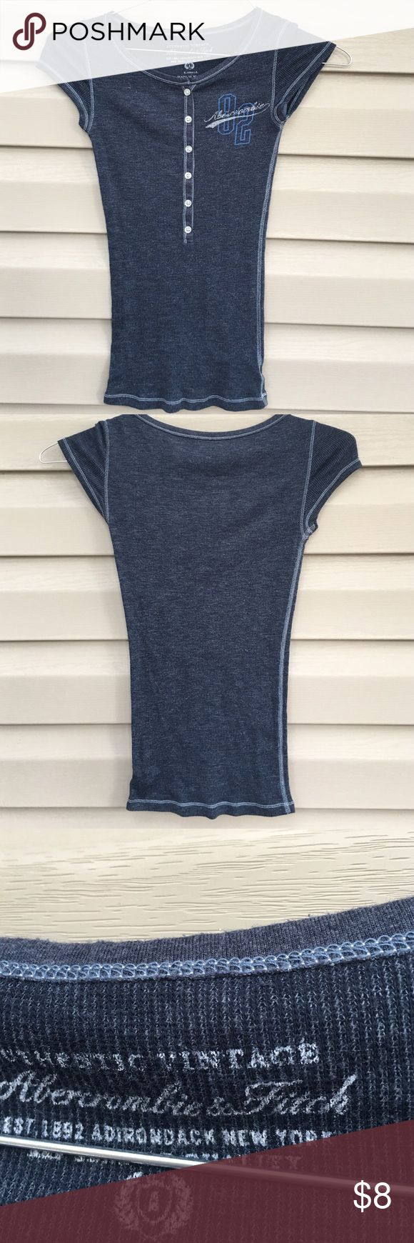 Abercrombie girls shirt Nice ribbed denim colored shirt with 6 buttons.64% cotton 36% polyester. No stains,snags or holes. Abercrombie & Fitch Tops Tees - Short Sleeve