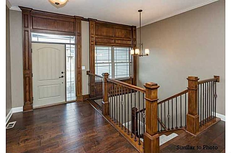 Gorgeous Woodwork And Staircase Design In Foyer Leading To