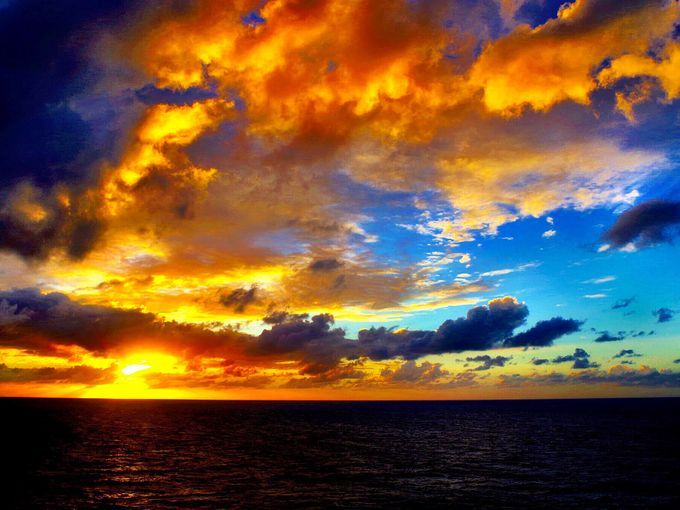 "A gorgeous Caribbean sky, ""like a painting.""  The photo"