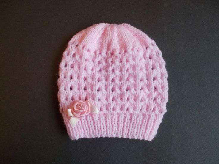 Ravelry: Melika Baby Hat pattern by marianna mel. I would omit the bow.