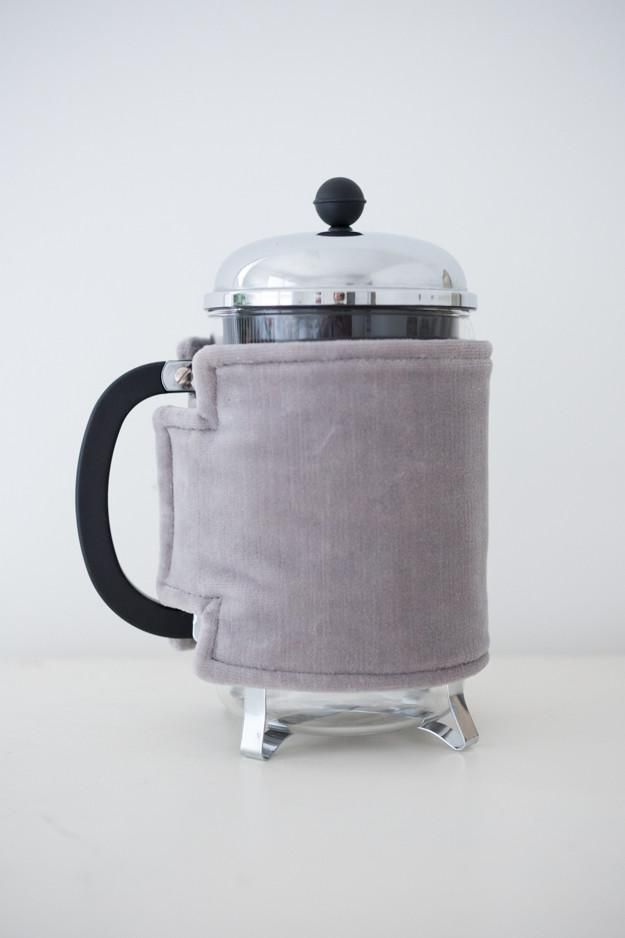 Coffee Coats are stylish French press covers designed to keep your coffee (or Tea) warmer. Each cozy is double sided with the same fabric (so they're reversible