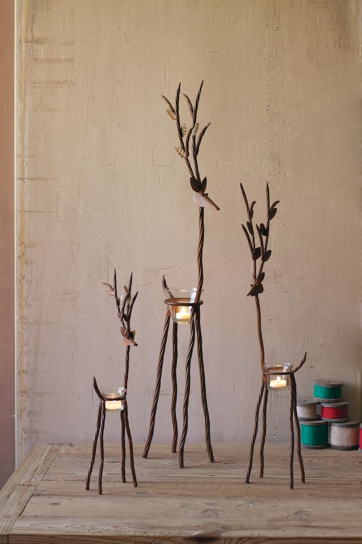This Set of 3 beautiful Reindeer provide a unique, rustic way to display any small candles and light up any dinner table, or Christmas display. This trio looks great displayed together, or lighting up