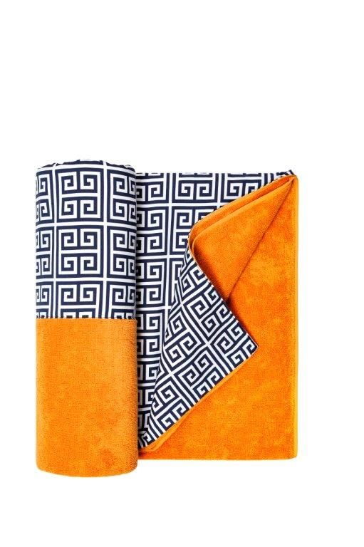 """The Hotel Grande Bretagne's beach towel, available in two wonderful shades of orange and blue, signifies its """"Greek"""" origin with its typical Meanders, its right angles and twisting lines."""