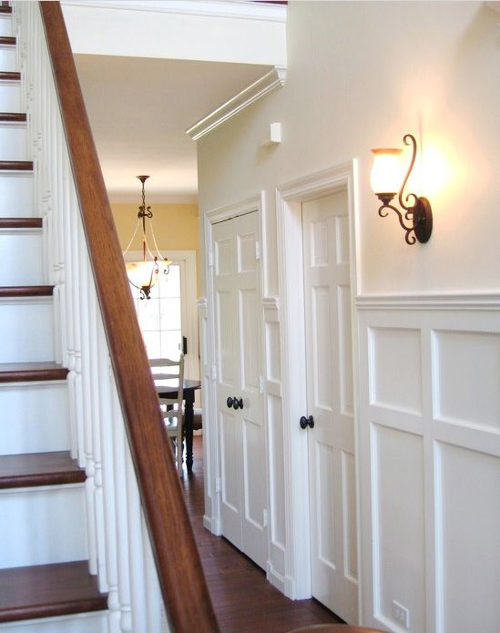 bronze fixtures, this is how our stairs will be, white trim, wood floors