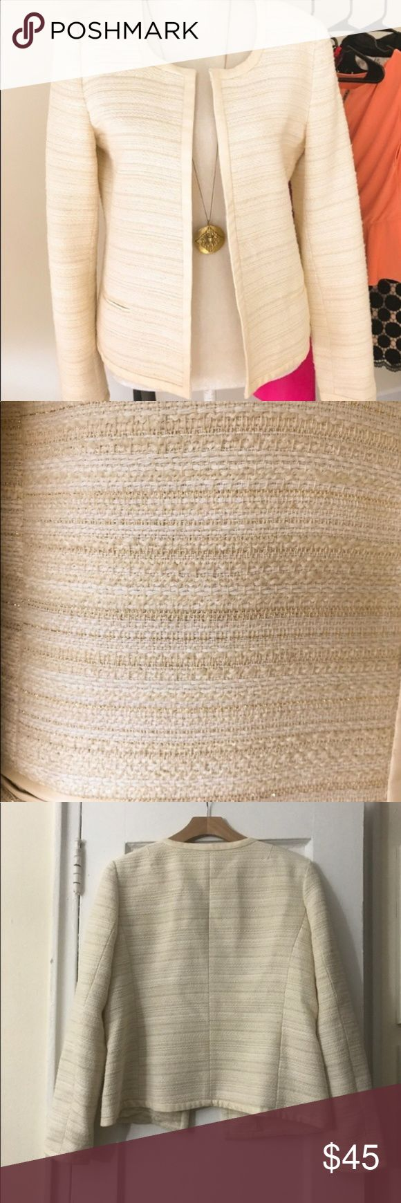 Banana Republic Metallic Tweed Open Jacket Gorgeous Metallic Tweed Open Front Jacket in perfect condition! No signs of wear. Cream, tan and metallic gold tweed with cream faux leather trim. Terrific winter white! Banana Republic Jackets & Coats Blazers
