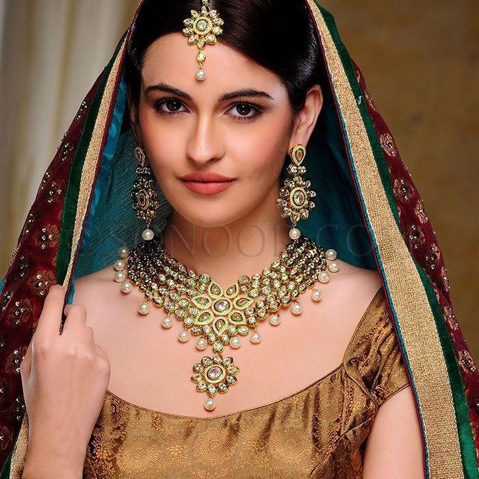 BRI/1/2809 Raji Bridal Set includes Necklace, Earrings, Haath Phool, and Maang Tika in dull gold finish studded with czee polki stones, meena kari, and pearl droplets  $598 £353