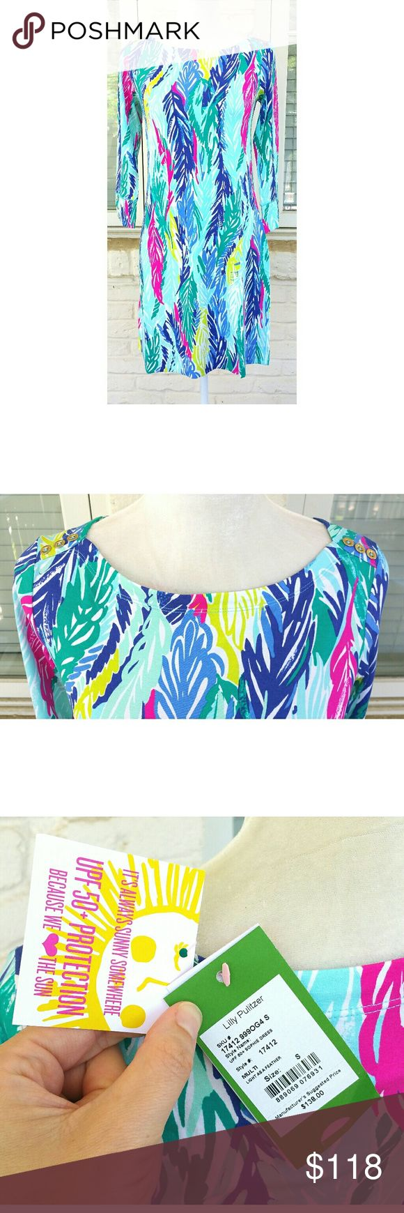 NWT, Lilly Pulitzer UPF 50+ Sophie Dress Dress smartly and stylishly for sunny days in the Sophie dress. ; Three-quarter sleeve dress in printed stretch rayon jersey. ; Fabric offers UPF 50+ protection. ; Boat neckline. ; Gold-tone buttons accent the shoulders and cuffs. ; Straight hemline. ; Slip-on. ; Unlined. ; 93% rayon, 7% spandex. ; Machine wash cold, lay flat to dry. ; Imported. Multicolor Print: LIGHT AS A FEATHER Lilly Pulitzer Dresses