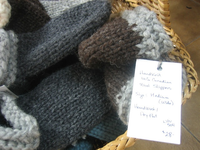 Textures:a combined effort of area artisansa.k.a. Textures Craftworks  -hand-knitted wool slippers by Lynne Therrien - $28