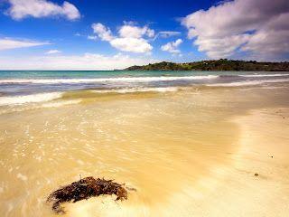 Wolken, zee en strand