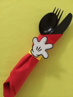 """Mickey Mouse First Birthday Party - Handi Helpers....Black plastic ware wrapped in a red napkin, """"tied"""" with a yellow card stock band and topped with a Mickey hand!"""