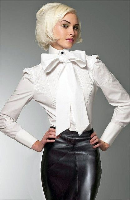 Classic look with leather skirt and white blouse with bow
