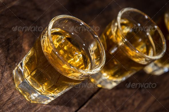 Line of Rum Shots on wooden background ...  Alcoholism, alcohol, amber, beverage, bourbon, brandy, brown, close-up, closeup, cocktail, cognac, cold, drink, glass, gold, golden, ice, liquid, liquor, macro, nobody, refreshment, rocks, rum, rum shot, scotch, scottish, shot, shots, unhealthy, vintage, whiskey, whisky