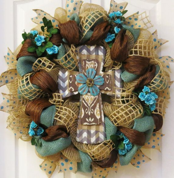 This lovely cross wreath is handcrafted with teal burlap and deco mesh with jute ribbon loops. Created with layers of stylish texture, burlap, and