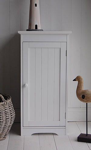 A white bathroom storage cabinet