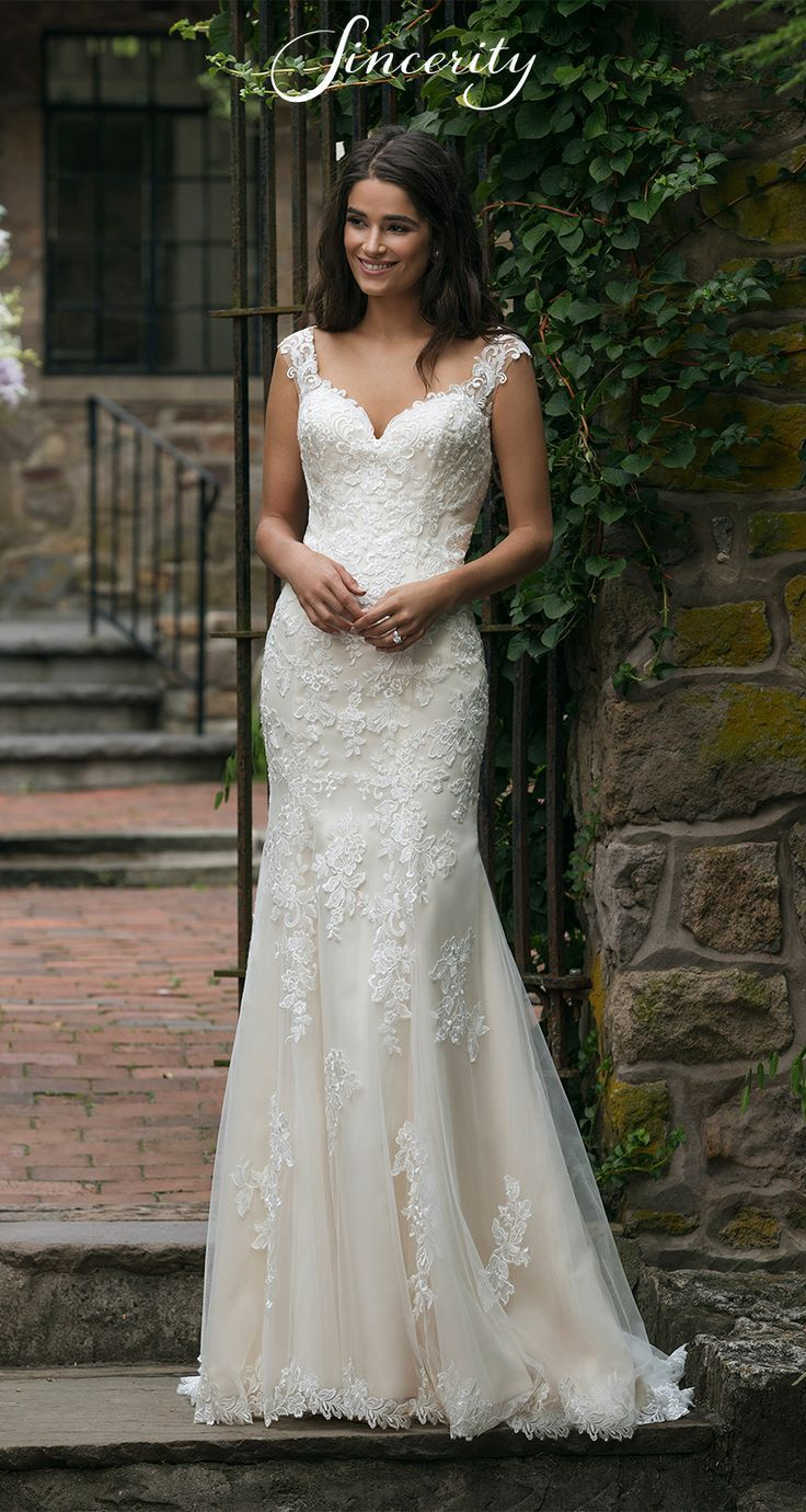 Style 44054: This fit and flare lace wedding dress…