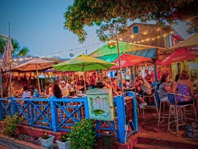 MustDo.com   Siesta Key Oyster Bar, S.K.O.B bar & restaurant. Big G's Crustacean Happy Hour daily from 3 to 6 p.m. Enjoy a dozen oysters on the half shell or Louisiana crawfish for just $6 bucks!