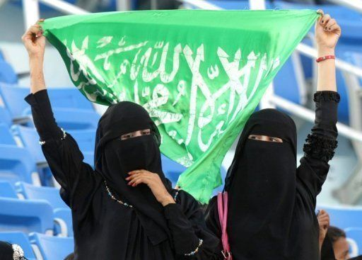 Saudi Arabia, Qatar and Brunei have been the only three countries yet to send women athletes to the Olympics  Saudi women hold up their national flag as they watch a sports event in the southern Yemeni city of Aden. Two female athletes from Saudi Arabia will compete at the London Games this summer in a historic first for the country, the International Olympic Committee said © Karim Sahib - AFP/File