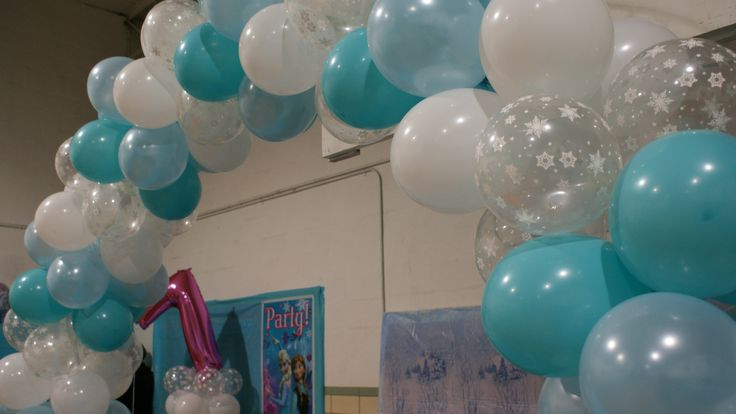 Blue And Snowflake Balloon Arch Over Gift Table For Kylie