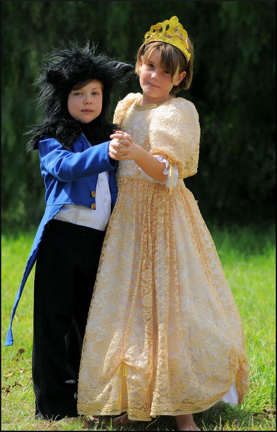 A child's Beast costume with a furry hood, blue coat, white top and black pants. Beauty and the Beast Belle and Beast Kids Child costumes. Halloween.