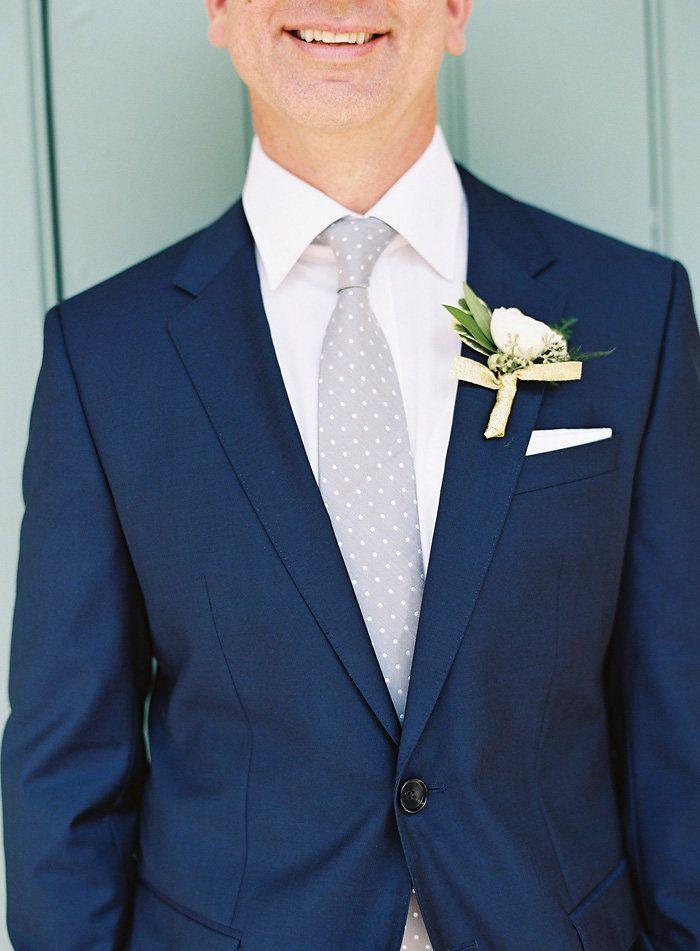 Groom   Attire Idea: Navy suit and grey tie.