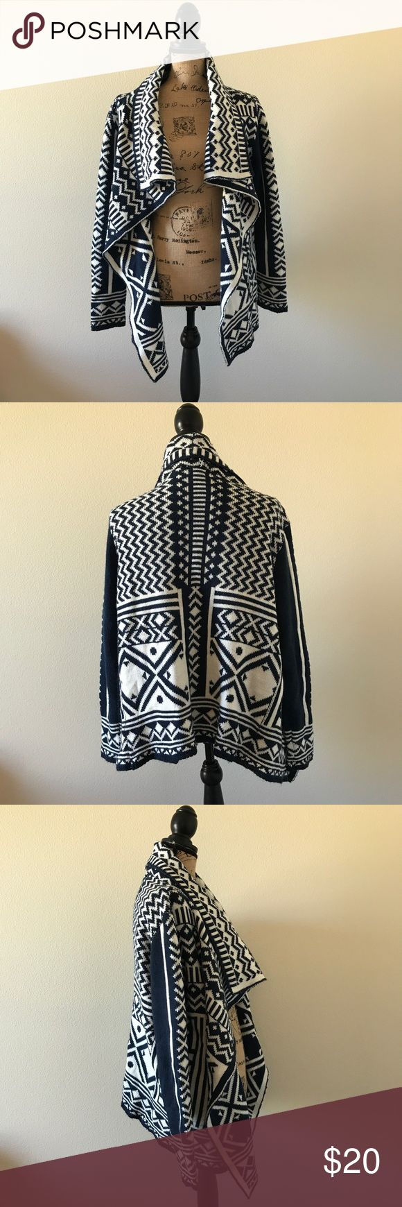 Woven Heart Tribal Print Cardigan Sweater Medium Woven Heart Tribal Print Cardigan Sweater Size Medium!  Navy and white color.  Very warm and comfortable!  Still in very good condition! Woven Heart Sweaters