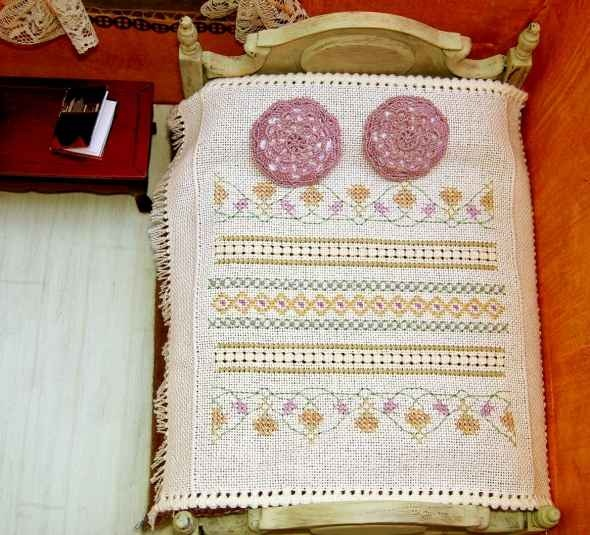 Dollhouse bedspread features antique needlework stitches and pulled thread edgings.