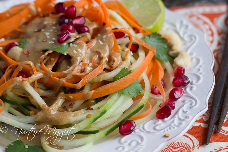 Easy Thai Cucumber Noodle Salad tossed in a homemade ginger sesame dressing & garnished with pomegranate seeds, cashews & sesame seeds. Deliciously healthy!
