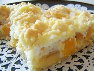 Peachy Keen Bars  1 pkg	dry cake mix-white, yellor or french vanilla 1/3 c	butter, room temperature 2 lg	eggs, divided 29 oz	can light peach slices, drained 8 oz	cream cheese, room temperature 1/3 c	sugar 1 tsp	pure vanilla extract