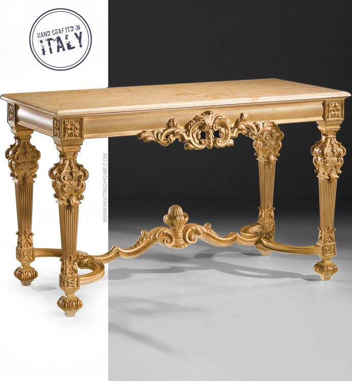 Louis XIV style carved wood console table in pickled pine finish. Louis XIV console table has gold-leaf accents and Valencia marble top with beveled edge. This console table is hand made in Italy; available at InvitingHome.com