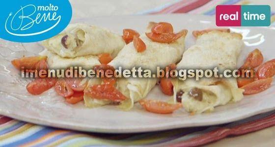 cannelloni di pane carasau 1melanzana incidere la polpa Cospargerla con sale,in teglia con carta forno, buccia in alto. 200°con grill 20-25 m. bagnare 1 disco pane carasau con acqua e tagliarlo a strisce.polpa della melanzana fredda con 75g caprino, olio, 2 cucchiai  parmigiano, 6 olive taggiasche snocciolate, sale e pepe.Farcire le strisce e arrotolarle. cannelloni in una teglia unta e spennellare con un po' di burro. parmigiano, sale e pomodorini. grill