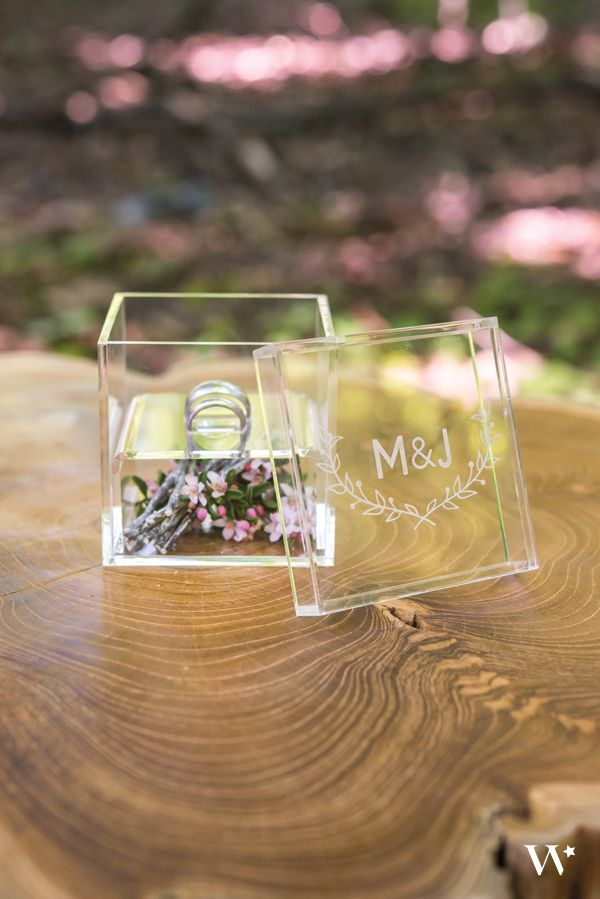This impressive miniature box makes an ideal showcase for your precious wedding rings. Engraved with a woodland inspired monogram, this unique ring box will add a touch of modern to any wedding. Add rustic moss, leaves or twigs that fit perfectly with the woodland theme to create a picture perfect setting.